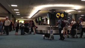 Slow motion of YVR Airport baggage claim with luggage spinning around conveyor. Stock Images