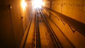 Slow movement of the car in the tunnel. City transport, the subway car drove into the tunnel and moved to the station.  stock footage