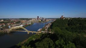 Slow Moving Forward Aerial View of Pittsburgh from West End Overlook. 8475 PITTSBURGH - Circa May, 2017 - An early evening slowly moving forward aerial view of stock video