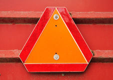 Slow Moving Vehicle Sign. Orange and Red Reflective Slow Moving Vehicle Sign stock photos