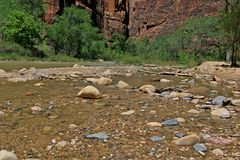 Slow moving water coming out of the Narrows. Flash floods can create dangerous conditions at the  Narrows at Zion National Park Royalty Free Stock Photo