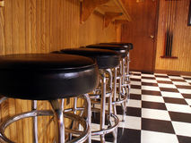 Slow night. Empty bar stools lined up in bar stock images
