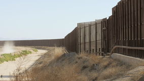 Slow Pan of Border Fence Between the US and Mexico
