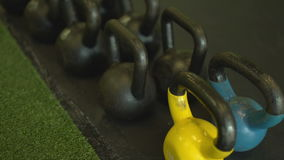Slow pan over weights in a gym stock video footage