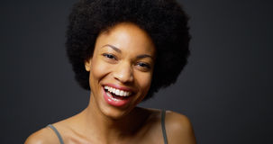 Slow pan up African woman laughing and smiling Royalty Free Stock Photo