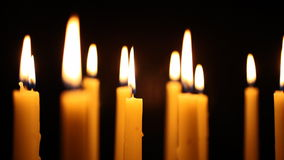 Slow Panning Down shot of Tall Candles stock video