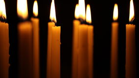 Slow Panning up shot of Tall Candles stock video