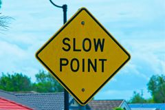 Slow Point road sign in Australia. Slow Point road sign as a warning to cars of traffic conditions ahead stock photography