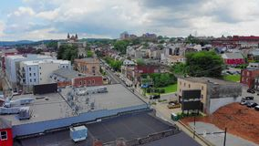 Slow Reverse Aerial Push Establishing Shot of Lawrenceville Pennsylvania. A slow reverse aerial push establishing shot of the business district of Lawrenceville stock video footage