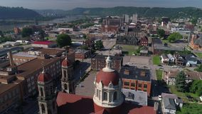 Slow Rising Aerial Establishing Shot of Steubenville Ohio. A slow rising reverse aerial establishing shot (DX) of the small rust belt Ohio town of Steubenville stock footage