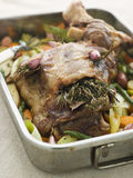 Slow Roasted Shoulder Of Lamb Stuffed With Herbs Stock Photography