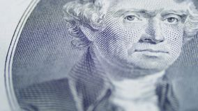 Slow Rotating Thomas Jefferson Face on Two Dollar Bill. In Macro. Background with money american bills. Banknotes, cash money background. Rotation paper money stock footage