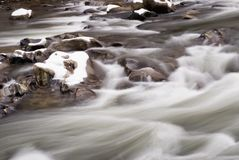 Patapsco River Maryland USA with Snow Covered Rocks Royalty Free Stock Photo