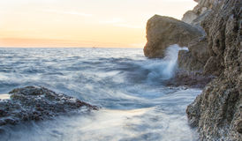 Slow shutter speed capture of the waves pounding on rocks, Croat. Beautiful blur waves at the rock banks of Dubrovnik Stock Photos