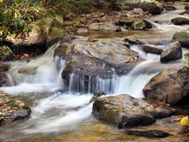 Slow Shutter Speed Image of a Waterfall in a Rocky Georgia Stream in the Fall of the Year. Slow Shutter Speed Image of a Beautiful Waterfall in a Rocky Georgia royalty free stock photo