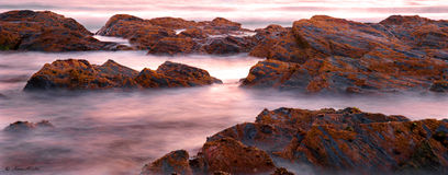 Slow Shutter Speed Shot of ocean and rocks Royalty Free Stock Photo