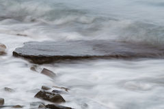 Slow shutter waves. On the sea coast Royalty Free Stock Photography
