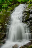 Slow Shutterspeed of Waterfall. A slow shutter speed captures water cascading off of a rock face at Amicalola Falls in Georgia royalty free stock photo