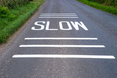 Slow Sign freshly painted on road Royalty Free Stock Photography