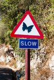 Slow sign on Gibraltar. Butterfly signpost, special sign, animal sign stock image