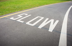 Slow sign painted on the road Stock Image