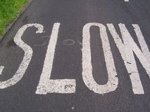 Slow Sign painted on road Stock Images