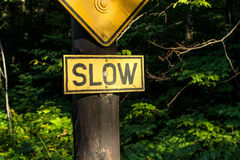 Slow Sign. A picture of a slow sign on a country road in Canada stock photo