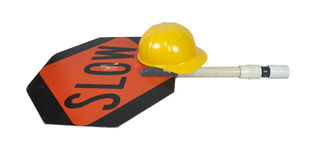 Slow Sign on Pole with Construction Hat Stock Images