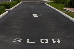 Slow sign on the road Stock Photography