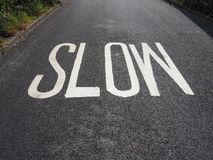 Slow sign on street. Speed limit slow sign on a street stock photo