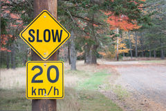 Slow Sign. Slow to 20 km sign in rural park setting royalty free stock images