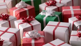 Slow slide over lots of wrapped presents stock video footage