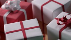 Slow slide over lots of wrapped presents ready for delivery stock video footage