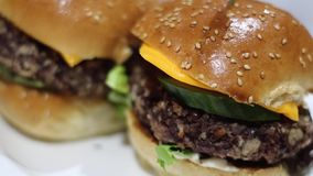 Veggie burgers on the board stock video footage