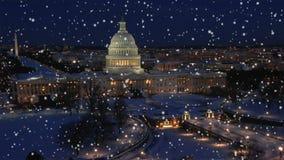 Slow snowfall over washington d.c. town at night