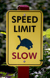 Slow speed limit sign stock photo