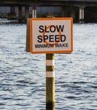 Slow Speed Minimum Wake sign in Hillsborough river. In Tampa. Florida, USA stock photos