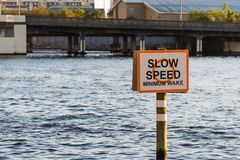 Slow speed sign in Hillsborough river in Tampa. Florida, USA stock photography