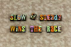 Slow steady win race focus. Typography letterpress message enter wins preparation success positive attitude thinking help helping consistent ready contest stock photo