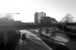 Slow traffic, car driving on abandoned road. royalty free stock image