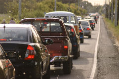 Slow traffic on the road. Row of cars in a traffic jam on the road Stock Images