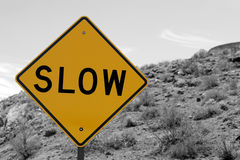 Slow traffic sign. Slow ahead traffic sign in the desert Royalty Free Stock Photo