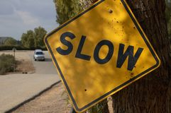 Slow Traffic Sign. An old slow traffic sign on a country road Stock Images