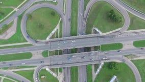 Slow vertical landing over viaduct crossroad stock video