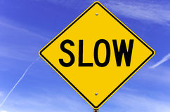 Slow Warning Sign against Blue Sky Stock Photos