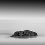 Slow water. Beautiful minimalistic black and white seascape. shot taken in daytime with long exposure. black sea, ukraine, odessa Royalty Free Stock Image
