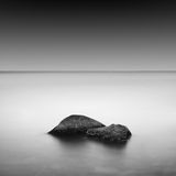 Slow water. Beautiful minimalistic black and white seascape. shot taken in daytime with long exposure. black sea, ukraine, odessa Stock Photo