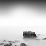 Slow water. Beautiful minimalistic black and white seascape. shot taken in daytime with long exposure. black sea, ukraine, odessa Stock Photos