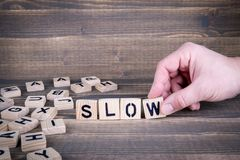 Slow. Wooden letters on the office desk royalty free stock image