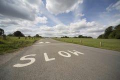 SLOW writen in road Royalty Free Stock Photo